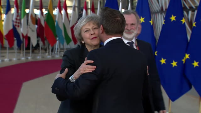 Theresa May greeting Luxembourg Prime Minister Xavier Bettel on a visit to the EU Parliament building
