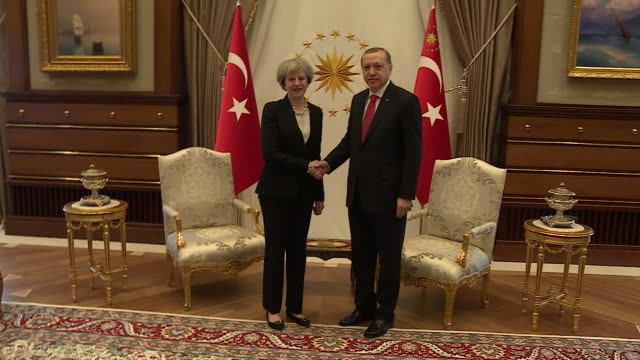 Theresa may greeting turkish president recep tayyip erdogan at the theresa may greeting turkish president recep tayyip erdogan at the stock footage video getty images m4hsunfo