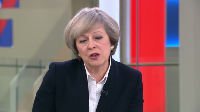 theresa may has accused the media of misrepresenting her words on brexit leading to a slump in the pound sterling dropped more than one per cent... - impact stock videos and b-roll footage