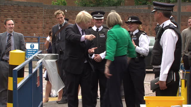 theresa may, home secretary & and boris johnson, london mayor, go to croydon to see the work being done to tackle violent crime involving young... - ロンドン クロイドン点の映像素材/bロール