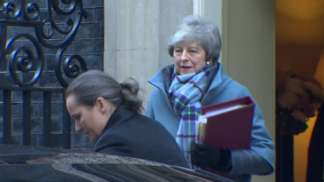 theresa may leaves 10 downing street to meet with jeremy corbyn to discuss the brexit deal - theresa may stock videos & royalty-free footage