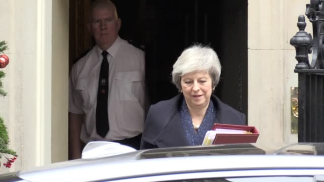 pm theresa may leaves downing street for pmqs after a noconfidence vote is triggered against her - prime minister's questions stock videos & royalty-free footage