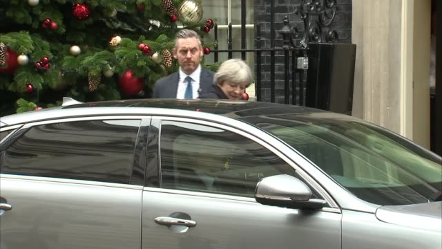 theresa may leaves downing street for pmqs england london downing street ext theresa may mp leaving number ten and into car / car away - number 10 stock videos & royalty-free footage