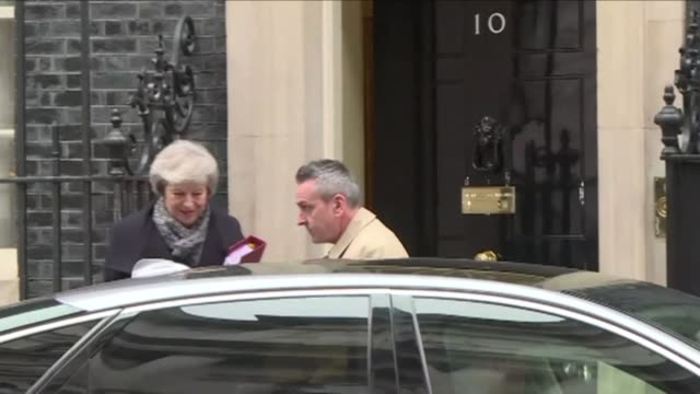 theresa may leaves no 10 downing street to head to prime minister's questions in parliament the day after a bill on her brexit deal suffered the... - defeat stock videos & royalty-free footage