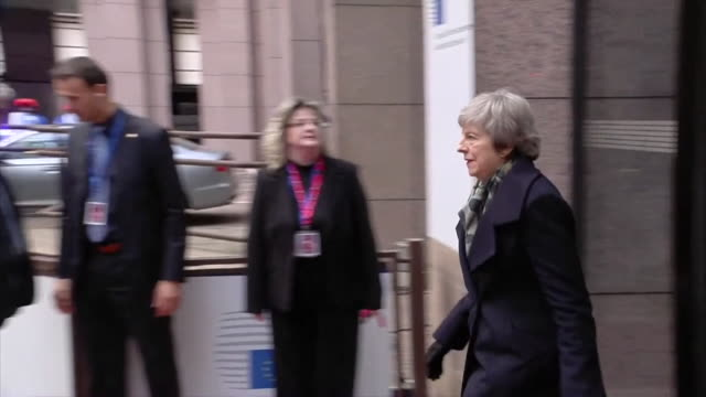 Theresa May leaving European Council building in Brussels