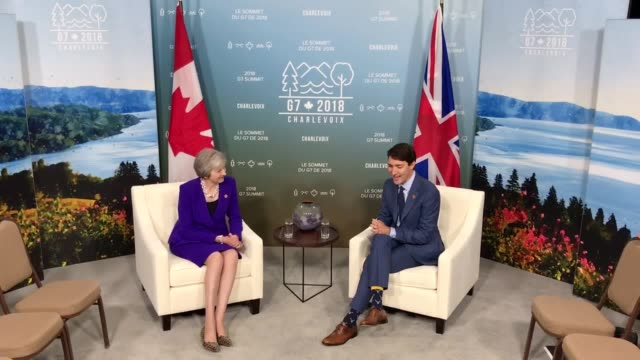 theresa may meets justin trudeau at the g7 summit in canada the leaders of canada the us the uk france italy japan and germany are meeting in the... - アンゲラ・メルケル点の映像素材/bロール