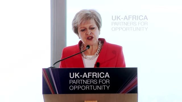 Theresa May pledges £4 billion of extra investment to Africa as threeday trade mission begins Cape Town South Africa Theresa May dancing press...