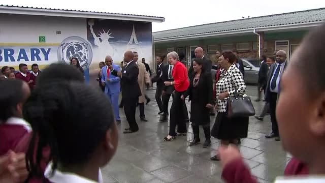 theresa may pledges £4 billion of extra investment to africa as threeday trade mission begins south africa cape town ext theresa may mp dancing at... - theresa may stock videos & royalty-free footage