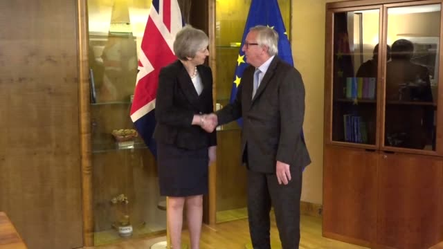 theresa may pm and european commission president jeanclaude juncker shake hands at photocall at last ditch brexit deal talks in strasbourg france - smiling stock videos & royalty-free footage