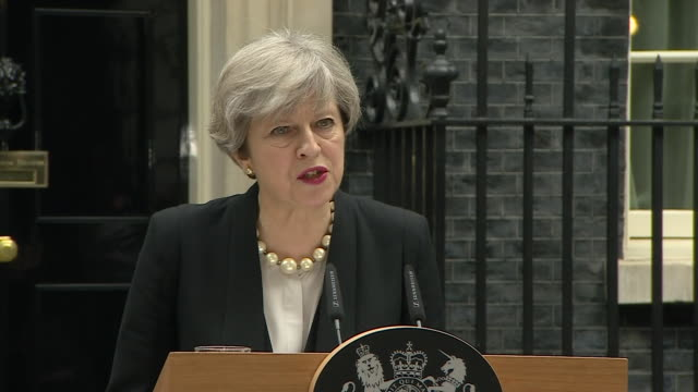 theresa may praising the generosity and spirit of the people of manchester after the manchester arena bombing saying it will never be broken - nhs stock videos & royalty-free footage