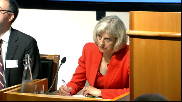 theresa may reaction to latest islamic state video of beheading; england: london: int theresa may mp comments at press conference on beheading of... - isis beheading stock-videos und b-roll-filmmaterial