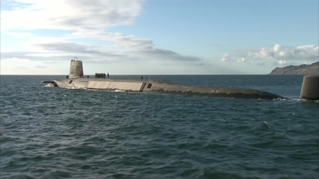 theresa may refuses to confirm prior knowledge of trident malfunction lib / en route to faslane various of submarine hms victorious at sea and with... - 三叉槍点の映像素材/bロール