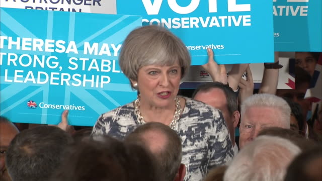 Theresa May saying let us reignite the British spirit because together we can do great things at her final campaign rally before the election