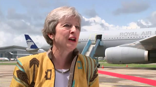 theresa may saying she wants to enhance trading links between the uk and nigeria - kettenglied stock-videos und b-roll-filmmaterial