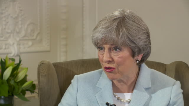 Theresa May saying the NHS 'is delivering for people'