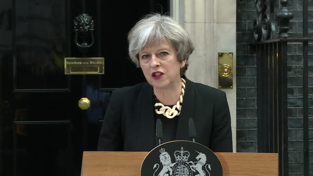 Theresa May saying while the Manchester and London terror attacks were not connected by common networks they were 'bound together by the single evil...