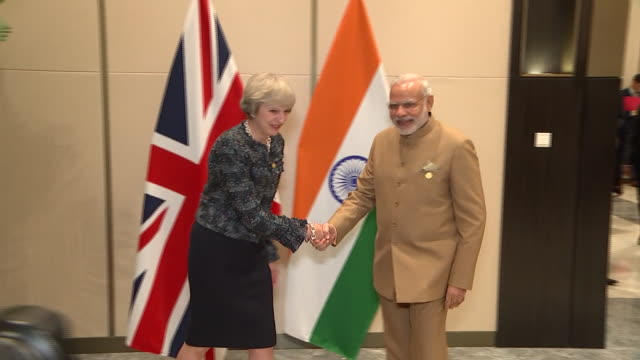 theresa may shaking hands with indian prime minister narendra modi at the g20 summit in hangzhou china - group of 20 stock videos & royalty-free footage