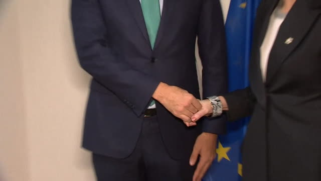Theresa May shaking hands with Leo Varadkar at the EU Parliament building