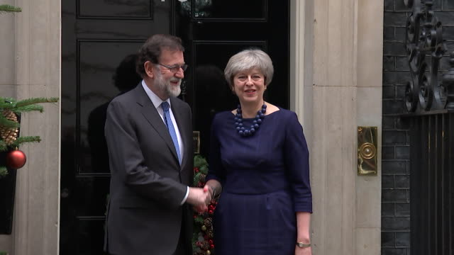 Theresa May shaking hands with Spanish Prime Minister Mariano Rajoy outside 10 Downing Street