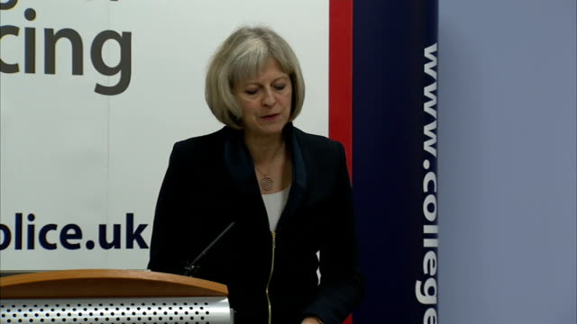 theresa may speech to college of policing england coventry int theresa may mp along to podium and speech sot it is a pleasure to be back at the... - domestic staff stock videos & royalty-free footage