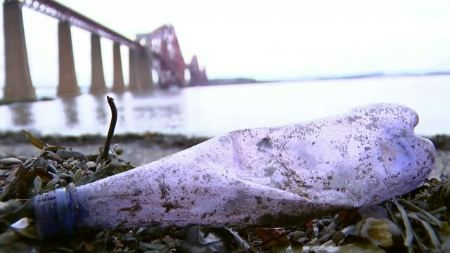 Theresa May stakes claim to green mantle with environment plan T09021748 / TX Fife EXT Plastic bottle on shoreline of Firth of Forth with Forth...