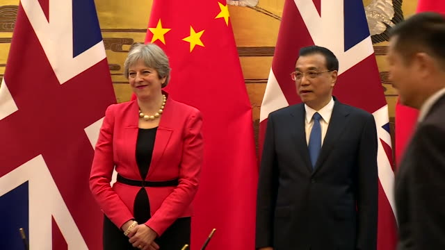 theresa may standing with chinese premier li keqiang as liam fox signs documents - liam fox politician stock videos and b-roll footage