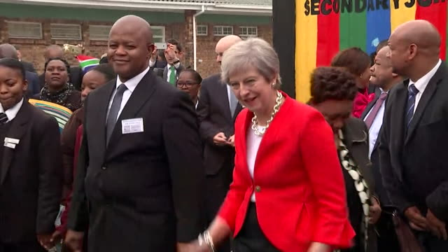 theresa may taking part in a traditional dance on a visit to south africa - theresa may stock videos & royalty-free footage