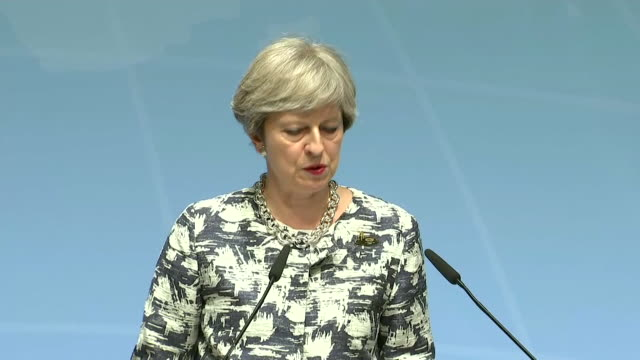 theresa may talks about her belief that industry should play a part in tackling terrorism - organisierte gruppe stock-videos und b-roll-filmmaterial