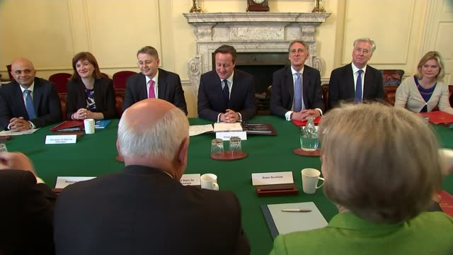 theresa may to be prime minister: new cabinet predictions; date unknown may sitting with chris grayling mp and iain duncan snith mp at cabinet... - prime minister stock-videos und b-roll-filmmaterial