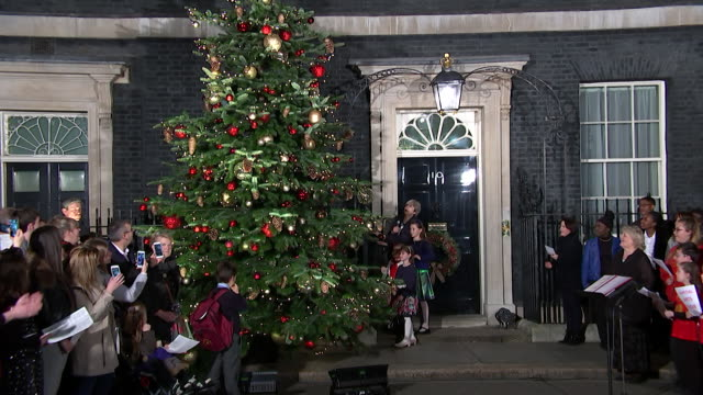 Theresa May turning on the Christmas lights outside 10 Downing Street