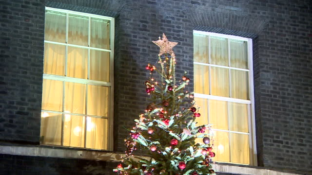 theresa may turning on the downing street christmas lights with school children - politician stock videos & royalty-free footage