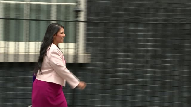 theresa may under pressure to sack boris johnson and priti patel over ministerial gaffes r110717002 ext priti patel mp along towards number 10 - priti patel stock-videos und b-roll-filmmaterial