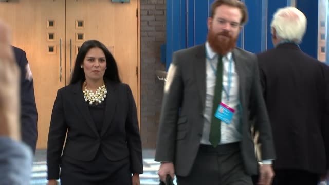 theresa may under pressure to sack boris johnson and priti patel over ministerial gaffes october 2017 priti patel mp towards along walkway - priti patel stock-videos und b-roll-filmmaterial