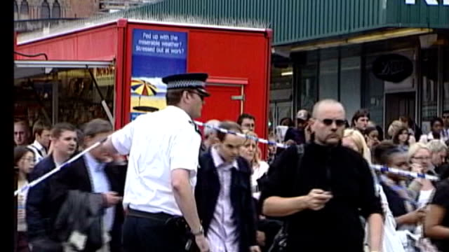 theresa may unveils new anti-terror measures; 7th july 2005 day people away from kings cross station after terorist attack woman along wrapped in... - blanket stock videos & royalty-free footage