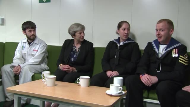 Theresa May visits HMS Queen Elizabeth at Portsmouth Naval Base Interview tour and cutaways of speech Various sped up shots of ship / Theresa May MP...