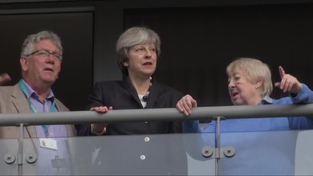 Theresa May visits new housing in Barnet ENGLAND London Barnet EXT Car arriving and Prime Minister Theresa May MP out and greeted / May into block of...