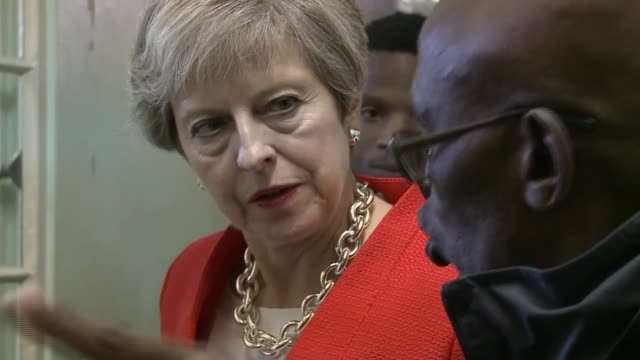 Theresa May visits Robben Island SOUTH AFRICA Robben Island INT Theresa May MP along corridor and being shown Nelson Mandela's prison cell / May...