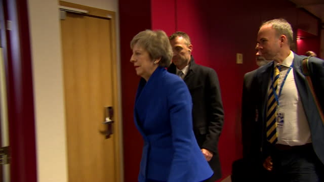 Theresa May walking to the lectern in the European Parliament building to announce she has confirmed a final Brexit deal with the EU