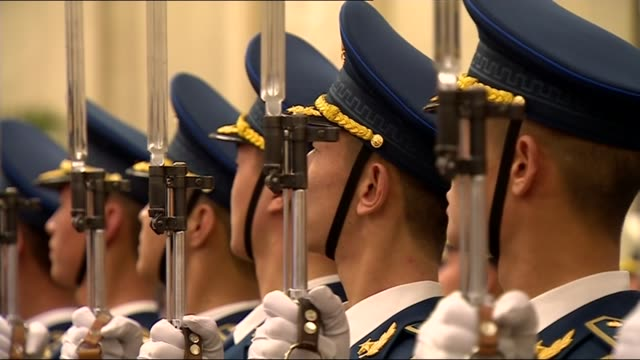 theresa may welcomed in great hall of the people china beijing great hall of the people int chinese and uk flags / troops in guard of honour march... - liam fox politician stock videos and b-roll footage