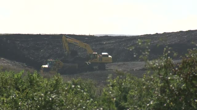 Theresa May will give the go ahead for Hinkley Point nuclear deal Mechanical diggers at site Machinery along Dipper trucks along Road at construction...