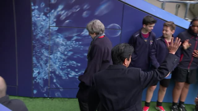 Theresa May with Shinzo Abe as the Japanese Prime Minister visits Twickenham Rugby Stadium