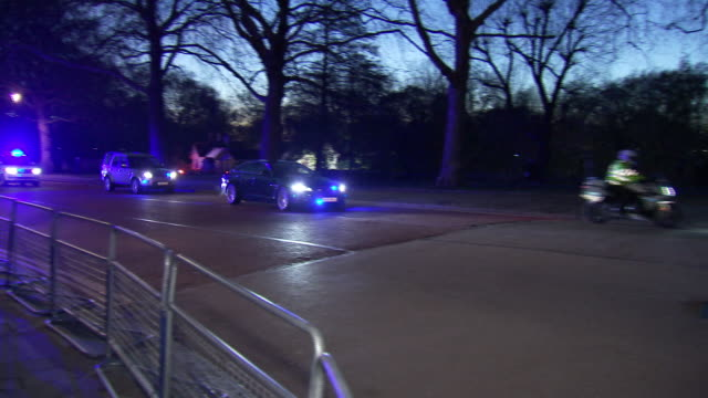 Theresa May's motorcade entering Downing Street at night