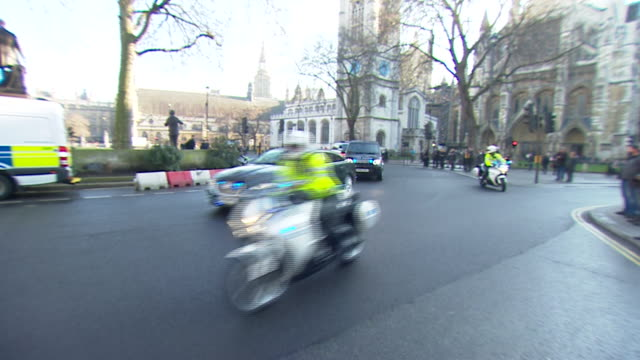 theresa may's motorcade leaving the supreme court after the court ruled article 50 could only be triggered with the approval of parliament - motorcade stock videos & royalty-free footage