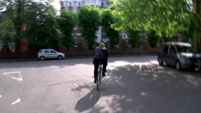 Theresa May's premiership on the brink as cabinet turn on her ENGLAND London Westminster EXT Boris Johnson MP riding a bicycle and ignoring press...