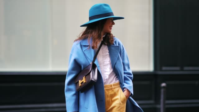 therese hellström wears a blue hat, a white ruffled shirt, a blue oversized blazer jacket, a hermes bag, pale yellow corduroy pants, brown pointy... - jacket stock videos & royalty-free footage
