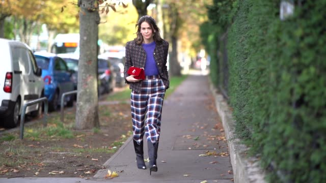 therese hellström wears a headband, a colored tweed jacket, a blue wool pullover, a red bag, checked pants, outside lacoste, during paris fashion... - kosmetisches stirnband stock-videos und b-roll-filmmaterial