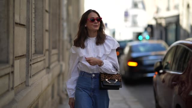 therese hellström wears red celine sunglasses, a white shirt / blouse from h&m with large ruffled collar, a black leather karl lagerfeld bag with a... - blouse stock videos & royalty-free footage