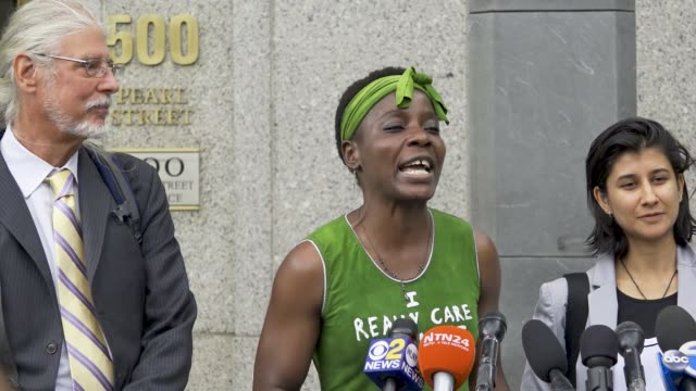 Therese Patricia Okoumou and her legal team hold a Court Date Press Conference after exiting the 500 Pearl Street district court house in the civic...
