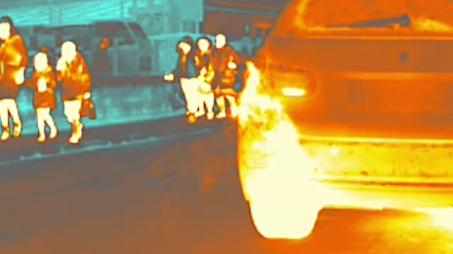thermal heat image camera showing close ups of exhaust fumes and pollution outside school in hammersmith, london - scientific imaging technique stock videos & royalty-free footage