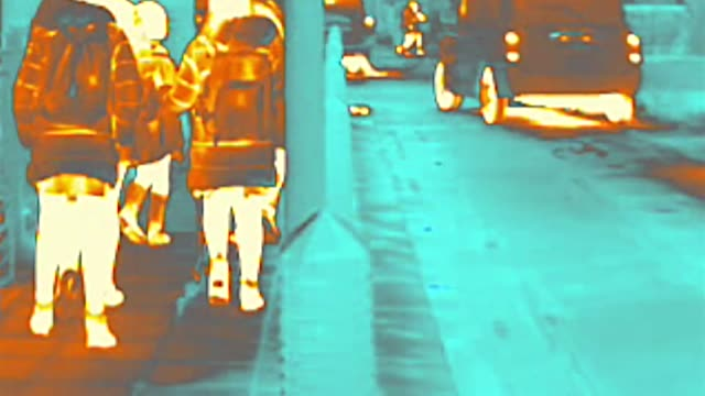 thermal heat image camera showing traffic and street scenes outside primary school in hammersmith, london - scientific imaging technique stock videos & royalty-free footage